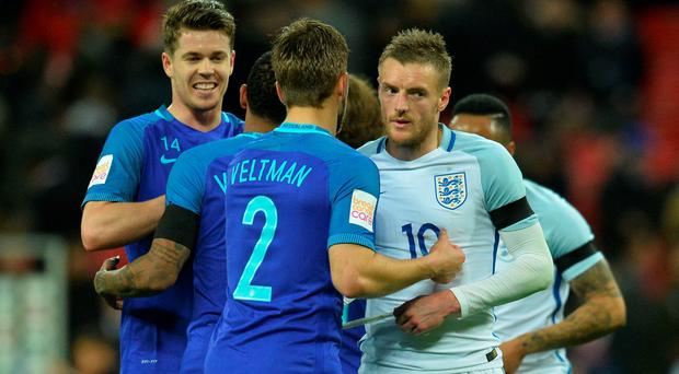 Sinking feeling: A despondent Jamie Vardy, who scored England's goal, shakes hands with Holland's Joel Veltman after the 2-1 defeat at Wembley last night