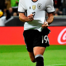 Winning smile: Mario Gotze is delighted after hitting the net