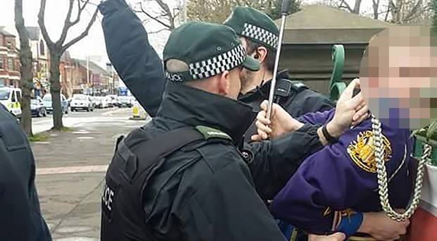Police make an arrest on the Ormeau Road.