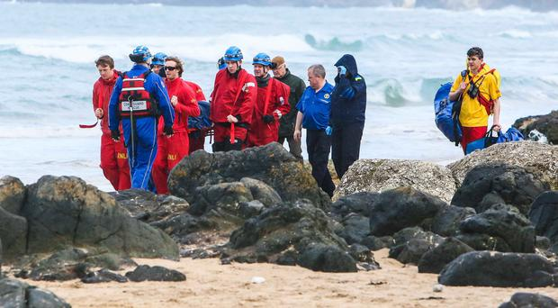 Coastguard teams from Coleraine and Ballycastle were tasked to assist the Ambulance service with an injured walker who had sustained injuries after falling from a cliff top at the White Rocks Beach Portrush. Photo: Matt Steele/McCauley Multimedia