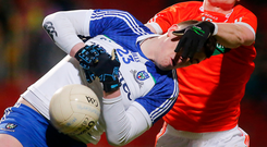 Hard fought: Monaghan's Michael McCarville under pressure from Armagh's Conor Martin at Pairc Esler, Newry last night