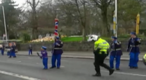 Police approach the Orange Order parade on the Ormeau Road