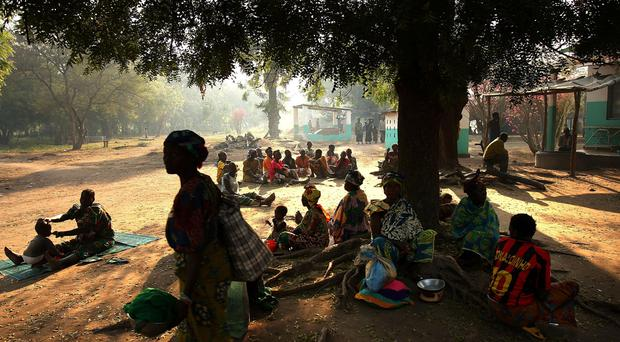People gather on the grounds of a hospital where relatives are being treated December 17, 2007 in Kabo in the northern Central African Republic. Central African Republic (CAR) is one of the world's poorest and most neglected countries with an average life expectancy of 39 years. Decades of fighting various rebel factions in the north of the country have resulted in hundreds of deaths and over 200,000 internally displaced people. Outside of the capital Bangui there is no electricity or paved roads and banditry is extensive. (Photo by Spencer Platt/Getty Images)