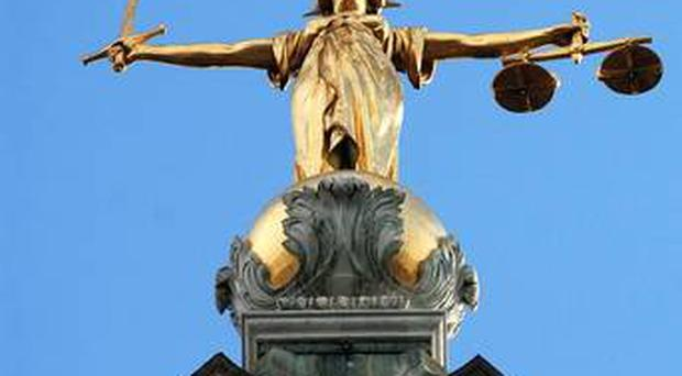 Two men who carried out a racist attack in Belfast city centre have been handed nine-month suspended jail terms.