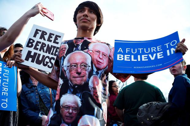 A supporter of US democratic presidential candidate Bernie Sanders arrives to attend a rally at the Saint Mary's Park in Bronx, New York,on March 31, 2016. / AFP PHOTO / Jewel SAMADJEWEL SAMAD/AFP/Getty Images