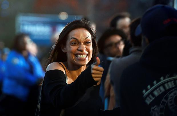 US actress Rosario Dawson greets Democratic presidential candidate Bernie Sanders's supporters during a campaign rally at the Saint Mary's Park in Bronx, New York, on March 31, 2016. / AFP PHOTO / Jewel SAMADJEWEL SAMAD/AFP/Getty Images