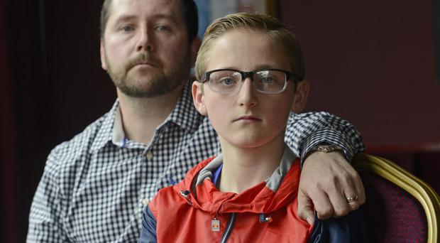 Christian King (12) speaks to the media with his Father George King, following the incident where CS spray was deployed by a PSNI officer during a Ormeau Road Parade. Pic Colm Lenaghan/Pacemaker