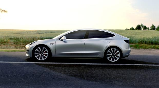 The Model 3 will cost 35,000 dollars (£24,423) and have a range of at least 215 miles (346km) per charge, the company's chief executive, Elon Musk, said. PA