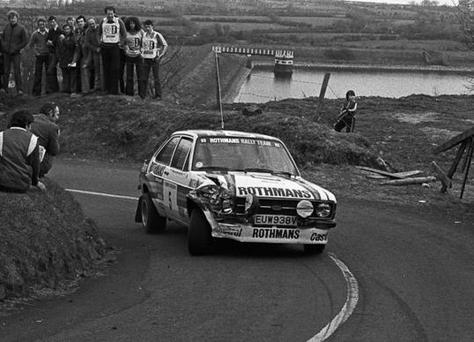 Crawling home: The battered Rothmans Ford Escort of Ari Vatanen and David Richards heads towards the Belfast finish after going off the road on the final leg in 1980