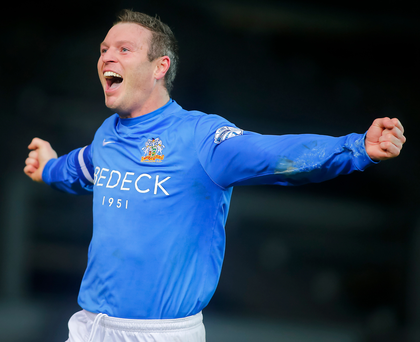 Cup of joy: Kevin Braniff celebrates after completing his hat-trick in Glenavon's Irish Cup semi-final with Crusaders. He would go on to score a fourth in a 4-3 win