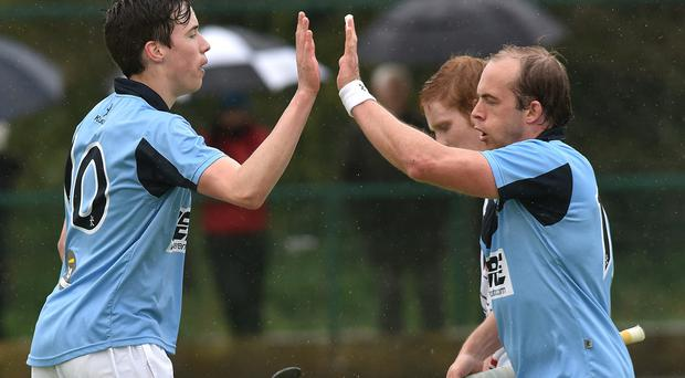 High five: Sean Murray and two-goal Timmy Cockram celebrate Lisnagarvey's All-Ireland title success