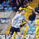 Cliftonville's Marc Smyth gets above Ballymena's Willie Faulkner