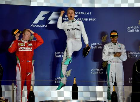 Jumping for joy: Nico Rosberg celebrates his win at the Bahrain Grand Prix, flanked on the podium by Kimi Raikkonen (left) and Lewis Hamilton