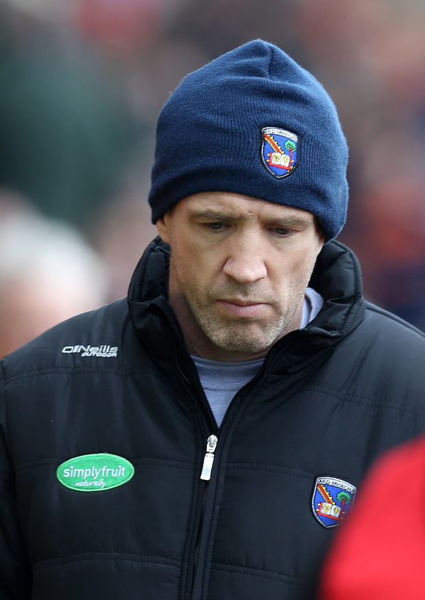 Sinking feeling: Armagh boss Kieran McGeeney despondent despite beating Derry