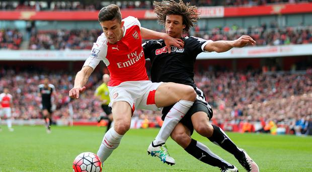 Still believes: Arsenal's Gabriel, holding off Nathan Ake, insists the Gunners can still win the league