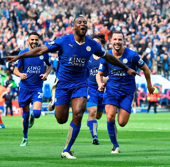 Victory roar: Wes Morgan is chased down by his delighted Leicester team-mates after grabbing the winner against Southampton