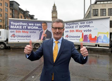 UUP leader Mike Nesbitt with his party's election billboards