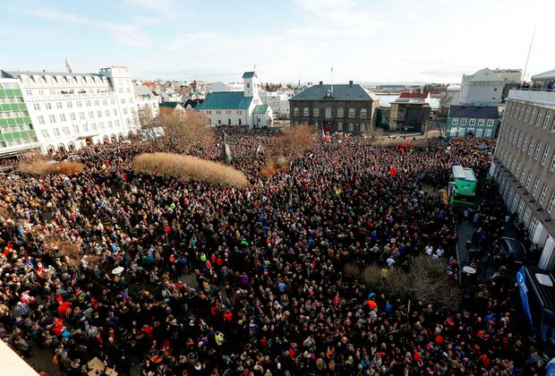 People gather to demonstrate against Iceland's prime minister, in Reykjavik on Monday April 4, 2016. (AP Photo/Brynjar Gunnarsson)