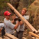 Undated Team Rubicon UK handout photo of Prince Harry (right) clearing a site to be used as a solar farm with volunteer Mark Laws, as he joined a disaster response charity rebuilding an earthquake destroyed school in the village of Lapubesi in Nepal. PA