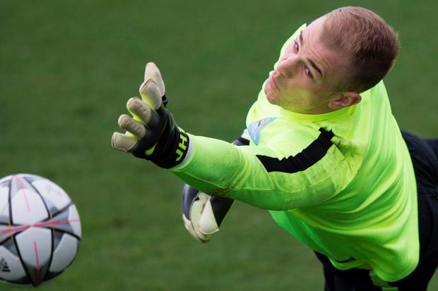 Hart stopper: Joe Hart saves a shot in training as he prepares to make a comeback from injury in Manchester City's Champions League quarter-final against Paris St Germain