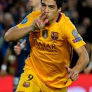 Barcelona's Luis Suarez celebrates after scoring his sides second goal during a Champions League quarter-final, first leg soccer match between FC Barcelona and Atletico Madrid at the Camp Nou stadium in Barcelona, Spain, Tuesday April 5, 2016. (AP Photo/Emilio Morenatti)