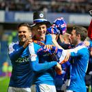 Going up: Rangers aces Harry Forrester (left) and Rob Kiernan (centre) celebrate their side's return to the top flight
