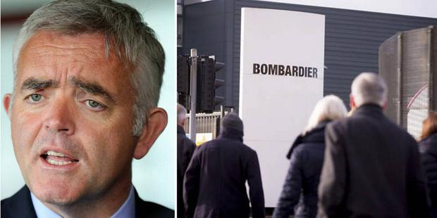 Enterprise Minister Jonathan Bell and Bombardier workers