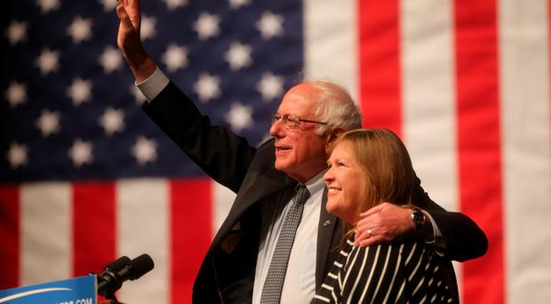 Democratic presidential candidate Sen. Bernie Sanders, I-Vt., waves to the crowd with his wife, Jane Sanders, by his side during a campaign rally Tuesday evening in the Arts and Sciences Auditorium at the University of Wyoming campus on April 5, 2016, in Laramie, Wyo. Sanders won the Democratic presidential primary in Wisconsin Tuesday. (Blaine McCartney/The Wyoming Tribune Eagle via AP)