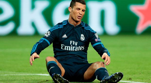 Cristiano Ronaldo of Real Madrid reacts during the UEFA Champions League Quarter Final First Leg match between VfL Wolfsburg and Real Madrid at Volkswagen Arena on April 6, 2016 in Wolfsburg, Germany. (Photo by Oliver Hardt/Bongarts/Getty Images)