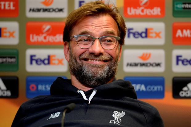 All smiles: Jurgen Klopp talks to the media in Dortmund but he says he'll celebrate if Liverpool score against his former team