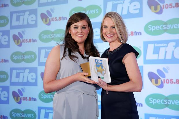 Danielle is presented with the U105 Young Persons Award by UTV's Sarah Clarke. Picture by Kelvin Boyes / Press Eye.
