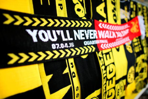 DORTMUND, GERMANY - APRIL 07: Scarves are displayed for sale outside the stadium before the UEFA Europa League quarter final first leg match between Borussia Dortmund and Liverpool at Signal Iduna Park on April 7, 2016 in Dortmund, Germany. (Photo by Lars Baron/Bongarts/Getty Images)