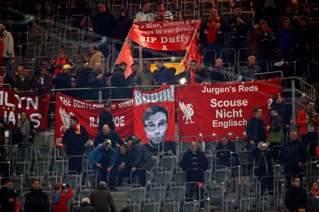 Liverpool's fans show a banner featuring their side's German head coach Jurgen Klopp prior to the UEFA Europe League quarter-final, first-leg football match Borussia Dortmund vs Liverpool FC in Dortmund, western Germany on April 7, 2016. AFP/Getty Images
