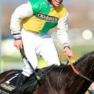 Jockey Leighton Aspell celebrates on board Many Clouds after victory in the Crabbie's Grand National Chase