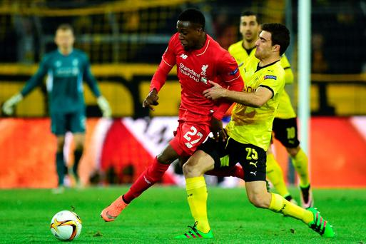 Liverpool's Belgian striker Divock Origi (L) and Dortmund's Greek defender Sokratis vie for the ball during the UEFA Europe League quarter-final, first-leg football match Borussia Dortmund vs Liverpool FC in Dortmund, western Germany on April 7, 2016. / AFP PHOTO / John MACDOUGALLJOHN MACDOUGALL/AFP/Getty Images
