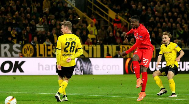 On the mark: Divock Origi puts Liverpool 1-0 up against Borussia Dortmund, before the Germans later equalised