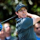 Major men: Rory McIlroy on his way to a first round 70 at Augusta after champion Jordan Spieth blazed a trail with his putter, shooting a six-under 66