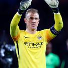 On the spot: Joe Hart salutes fans after City's draw in Paris