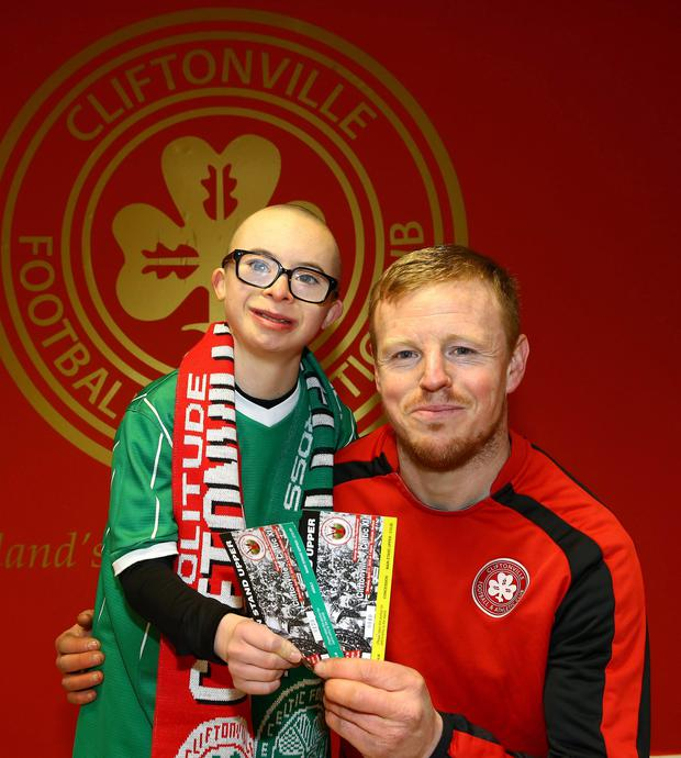 Big pals: George McMullan presents Jay Beatty with tickets to his Testimonial