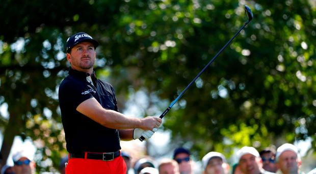 Pain game: Graeme McDowell missed the cut at Augusta