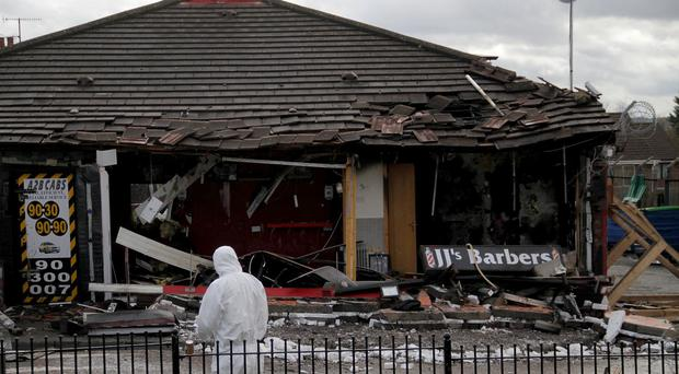 A2B Cabs and JJ's Barbers on the Glen Road Belfast were left damaged following an overnight fire. Picture Colm O'Reilly
