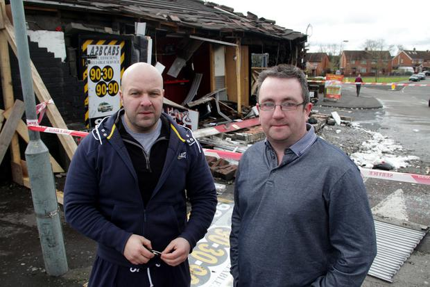 A2B Cabs and JJ's Barbers on the Glen Road Belfast were left damaged following an overnight fire. John Paul McCusker looks at what is left of his barbers with Stephen Comerford owner of A2B Cabs. Picture Colm O'Reilly