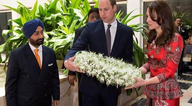 The Duke and Duchess of Cambridge lay a wreath at a memorial to victims of the terrorist attack at the Taj Mahal Palace hotel in Mumbai, India, on day one of the royal tour to India and Bhutan. Mark Cuthbert/UK Press/PA Wire