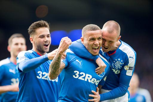 Rangers' James Tavernier (centre) celebrates scoring his side's second goal of the game during the Petrofac Training Scottish Cup final at Hampden Park, Glasgow. PRESS ASSOCIATION Photo. Picture date: Sunday April 10, 2016. See PA story SOCCER Final. Photo credit should read: Jeff Holmes/PA Wire.