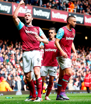 Treble yell: Andy Carroll celebrates the second goal in his hat-trick against Arsenal