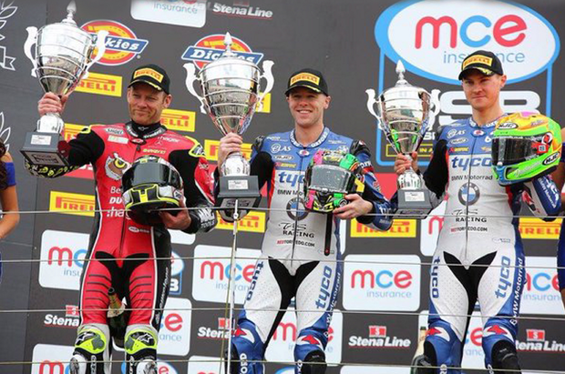 Top step: Shane Byrne (left), winner Michael Laverty and Christian Iddon