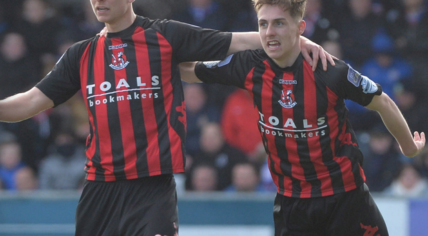 At the double: Crusaders duo Andrew Mitchell and Gavin Whyte celebrate after downing title rivals Linfield