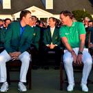 England's Danny Willett (R) speaks to US golfer Jordan Spieth during the presentation ceremony at the end of the 80th Masters Golf Tournament at the Augusta National Golf Club on April 10, 2016, in Augusta, Georgia. England's Danny Willett won the 80th Masters at Augusta National on Sunday for his first major title. He was trailing defending champion Jordan Spieth by five strokes around the turn, but stormed down the back nine to overhaul the American. Willett is the first Englishman since Nick Faldo 20 years ago to win the Masters and only the second all-time. / AFP PHOTO / Nicholas KammNICHOLAS KAMM/AFP/Getty Images