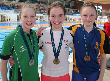 Medal joy: Julia Knox celebrates her gold in the 100m butterfly along with silver medalist Ellie McKibben, left and Katie Kimber