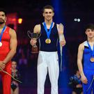 No horseplay: Rhys McClenaghan (right) joins pommel winner Max Whitlock (centre) and Louis Smith (left) on the podium